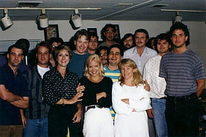 The Simpsons - Part of the writing staff of The Simpsons in 1992. Back row, left to right: Mike Mendel, Colin ABV Lewis (partial), Jeff Goldstein, Al Jean (partial), Conan O'Brien, Bill Oakley, Josh Weinstein, Mike Reiss, Ken Tsumura, George Meyer, John Swartzwelder, Jon Vitti (partial), CJ Gibson and David M. Stern. Front row, left to right: Dee Capelli, Lona Williams, and unknown.