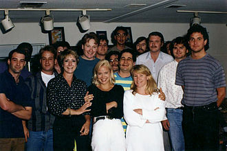 The Simpsons - Part of the writing staff of The Simpsons in 1992. Back row, left to right: Mike Mendel, Colin A. B. V. Lewis (partial), Jeff Goldstein, Al Jean (partial), Conan O'Brien, Bill Oakley, Josh Weinstein, Mike Reiss, Ken Tsumura, George Meyer, John Swartzwelder, Jon Vitti (partial), CJ Gibson and David M. Stern. Front row, left to right: Dee Capelli, Lona Williams, and unknown.