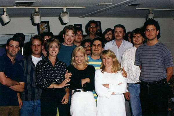 Part of the writing staff of The Simpsons in 1992. Back row, left to right: Mike Mendel, Colin A. B. V. Lewis (partial), Jeff Goldstein, Al Jean (partial), Conan O'Brien, Bill Oakley, Josh Weinstein, Mike Reiss, Ken Tsumura, George Meyer, John Swartzwelder, Jon Vitti (partial), CJ Gibson, and David M. Stern. Front row, left to right: Dee Capelli, Lona Williams, and unknown Simpsons writers2.jpg