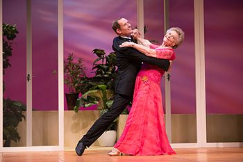 Todd McKenney and Nancye Hayes in a ballroom dancing pose while dancing in a performance of the play Six Dance Lessons in Six Weeks