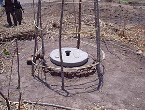 Arborloo - A squat slab covering the drop hole of an Arborloo in Malawi. The slab can be rolled from one location to the next.