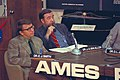 Space scientist James van Allen is seen smoking a pipe alongside physicist Edward Smith at a Pioneer 11 press conference in 1974..jpg