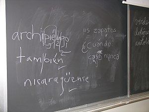 "Spanish orthography - Blackboard used in a university classroom shows students' efforts at placing ""ü"" and acute accent diacritic used in Spanish orthography."