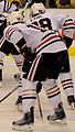 Stars-Hawks faceoff Kane and Sharp (5442433558).jpg
