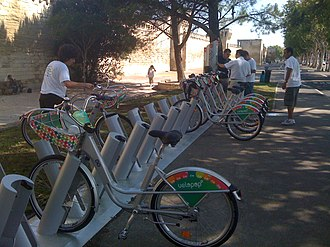 A velopop cycle station next to the city walls StationVelopop.JPG