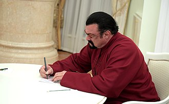 Steven Seagal - Seagal signing his Russian passport, November 2016
