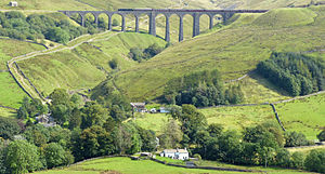 Dentdale - A steam train on the Arten Gill viaduct above Stonehouse