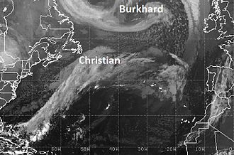 """St. Jude storm - Satellite image 26 October 2013 at 1012 UTC showing the position of the St. Jude Storm (Storm Christian) forming over Northern Atlantic. At the top of the image, the low pressure """"Burkhard""""."""