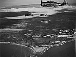 TBF Avenger Aircraft from USS ESSEX leaving the coast of French Indochina as they return to their carrier after strikes on the Saigon area, 12 January 1945.jpg