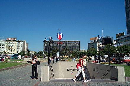 Ataturk Cultural Center at Taksim Square, with the entrance of the Taksim station of the Istanbul Metro. Taksim 4395.jpg