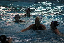 women playing water polo