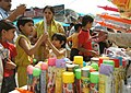 The Children are at the shopping centre on the eve of Holi Festival to purchase the colors and other belongings to celebrate Holi, in New Delhi on March 21, 2008.jpg