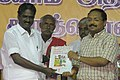 The Nagapattinam Member of Parliament Shri A K S Vijayan releasing the hand book on National Rural Employment Guarantee Act at the Public Information Campaign at Thirukuvalai village in Tamil Nadu on July 02, 2006.jpg