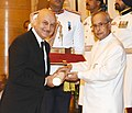 The President, Shri Pranab Mukherjee presenting the Padma Bhushan Award to Shri Anupam Pushkarnath Kher, at a Civil Investiture Ceremony, at Rashtrapati Bhavan, in New Delhi on March 28, 2016.jpg