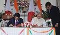 The Prime Minister, Shri Narendra Modi and the Prime Minister of Japan, Mr. Shinzo Abe at the signing ceremony, in New Delhi on December 12, 2015.jpg