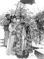 The Qing Dynasty Cixi Imperial Dowager Empress of China with Attendant.PNG