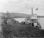 The S.S. Peace River docked at the landing at Fort St. John, British Columbia, 1913.jpg