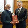 The Vice President, Shri M. Hamid Ansari presenting a copy of the Indian Constitution to the Speaker of the National Assembly of Hungary, Mr. Laszlo Kover, at Parliament, in Budapest, Hungary on October 17, 2016.jpg