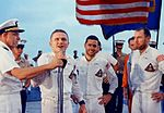 The crew of Apollo 8 addresses the crew of the USS Yorktown after a successful splashdown and recovery.jpg