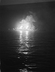 The cruiser HMS Belfast bombarding German positions in Normandy