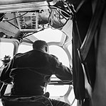 The navigator at work in a Lockheed Hudson of No. 269 Squadron flying an 'ice patrol' over the Denmark Strait between Iceland and Greenland, May 1942. CS172.jpg