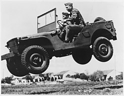 These soldiers go up in the air to prove that the Army's new quarter ton truck can take it. - NARA - 195336.jpg