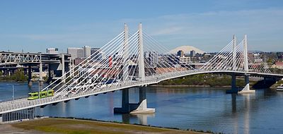 The 2015-opened Tilikum Crossing attracted national attention for being a major bridge open only to transit vehicles, cyclists and pedestrians, and not private motor vehicles. Tilikum Crossing with streetcar and MAX train in 2016.jpg