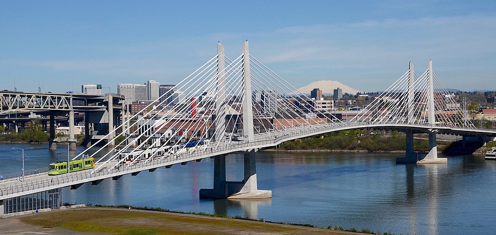 Tilikum Crossing with streetcar and MAX train in 2016