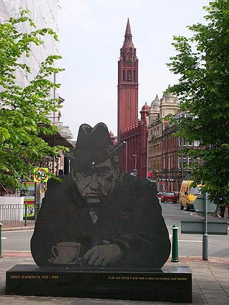 Birmingham City Centre -  Bruce Williams' 1996 Tony Hancock memorial in Old Square, with the Methodist Central Hall's tower behind.