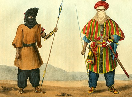 Armed Tuareg men depicted in a French book of 1821. Both men carry spears and the tellak dagger attached to the left forearm, the man on the right (a noble) is also armed with the takouba sword. Tuarick in a Shirt of Leather, Tuarick of Aghades.jpg
