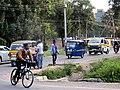 Tuk-tuks, cyclist on the move during rush hour.jpg