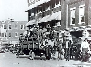 Tulsa race riot - National Guard with wounded.