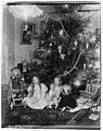 Two girls under a Christmas tree with their dolls, December 25, 1899 (MOHAI 7045).jpg