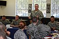 U.S. Air Force Gen. Mark A. Welsh III, standing, the chief of staff of the Air Force, speaks with Airmen at the Mosel Dining Hall at Spangdahlem Air Base, Germany, Aug. 1, 2013 130801-F-VS255-031.jpg