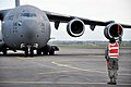 U.S. Air Force Senior Airman John Williams, a C-17 Globemaster III aircraft crew chief with the 517th Expeditionary Airlift Squadron, marshals an arriving C-17 Nov. 11, 2013, during Kiwi Flag as part of Southern 131111-F-FB147-065.jpg