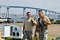 U.S. Airmen assigned to the California Air National Guard's Homeland Response Force (HRF) carry power cords during an emergency response training exercise at Naval Amphibious Base Coronado, Calif., May 24, 2013 130524-Z-UP142-145.jpg