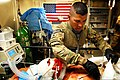 U.S. Army Spc. Leroy Granado, a medic with the 56th Infantry Brigade Combat Team, examines a wounded Afghan soldier in the intensive care unit at Multinational Base Tarin Kowt's Role Two Hospital in Uruzgan 130220-A-FS372-104.jpg