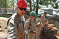 U.S. Army Staff Sgt. Matthew Zawel, left, with the 96th Troop Command, and Marines with the 9th Engineer Support Battalion pass bricks during renovation work at Erdmiin Oyun High School in Nalaikh district 130721-M-DR618-102.jpg