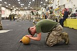 U.S. Marine Corps Lance Cpl. Collin Zaslov, with the command element of the 24th Marine Expeditionary Unit, completes a rigorous combat conditioning course during the Warrior of the Month event in the hangar bay 120501-M-RO494-031.jpg
