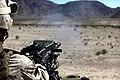 U.S. Marine with Engineer Company, Combat Logistics Regiment 2, 2nd Marine Logistics Group, fires a M19 at the crew serve weapon skills training during Enhanced Mojave Viper (EMV), on Marine Corps Air Ground 120902-M-KS710-042.jpg
