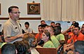 U.S. Navy Rear Adm. David F. Steindl, standing left, commander of Naval Service Training Command, talks with Navy junior ROTC cadets inside the Blue Jacket Memorial Chapel at Naval Station Great Lakes, Ill. 120621-N-IK959-693.jpg