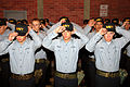 U.S. Navy recruits from Division 253 place Navy ball caps on their heads during a capping ceremony after ending training for Battle Stations 21 onboard USS Trayer (BST 21) at Naval Station Great Lakes, Ill. 070814-N-IK959-071.jpg