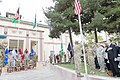 U.S. Service members, coalition partners and civilian guests render honors for the presentation of the colors during the International Security Assistance Force and U.S. Forces-Afghanistan change of command 140826-D-HU462-499.jpg