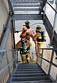 U.S. Soldiers carry a dummy victim out of a building and down stairs during a controlled burn training exercise held in Bedford, Mass., June 8, 2013 130608-A-IX584-169.jpg