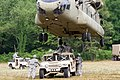 U.S. Soldiers with the 372nd Inland Cargo Transfer Company, 129th Combat Sustainment Support Battalion, 101st Sustainment Brigade, 101st Airborne Division, attach a Humvee to a CH-47 Chinook helicopter during 140626-A-LS265-206.jpg