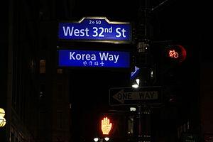 Koreatown, Manhattan - The Korea Way sign illuminated at night, with Hangul (한글) translation
