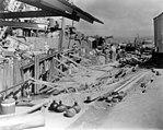 USS Helena (CL-50) at damaged 1010 dock, Pearl Harbor, 7 December 1941 (NH 96665).jpg