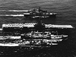 USS Tappahannock (AO-43) and USS Mars (AFS-1) replenish USS Oriskany (CVA-34), USS Wiltsie (DD-716) and USS Perkins (DD-877) off Vietnam, in May 1969 (USN 1139357).jpg