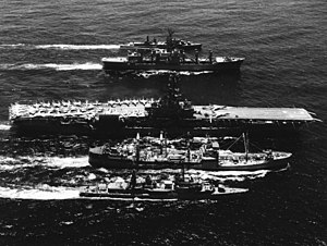 Ships of the 7th Fleet replenishing in the South China Sea during the Vietnam War, May 1969. From front to back: the destroyer USS Wiltsie (DD-716), fleet oiler USS Tappahannock (AO-43), attack aircraft carrier USS Oriskany (CVA-34), combat stores ship USS Mars (AFS-1), and USS Perkins (DD-877)
