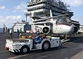 US Navy 030127-N-4965F-504 An aircraft tow tractor moves an S-3B Viking.jpg